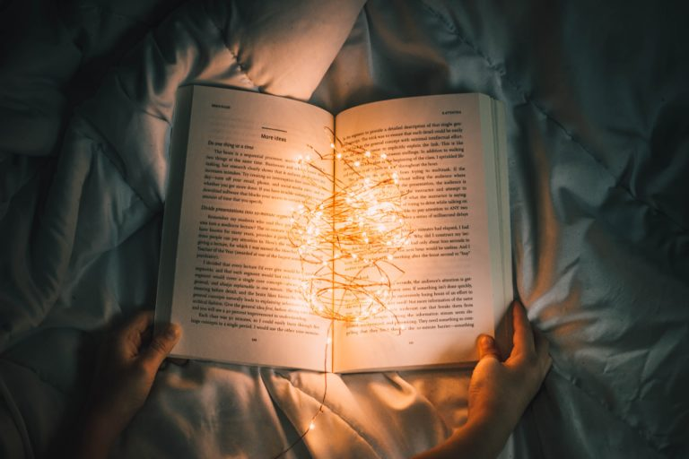A book that is lit up with bright lights that illuminate the pages
